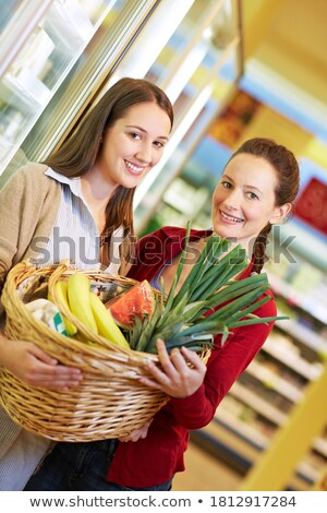 Mother and daughter carrying baskets full of vegetables Stock photo © photography33