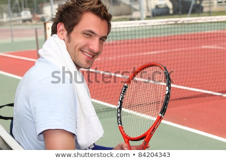 Young tennis player sitting on the court sidelines Stock photo © photography33