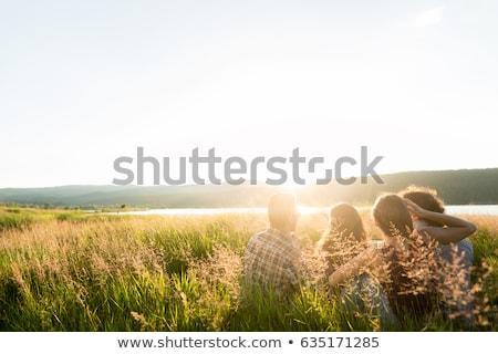 Kız yaz akşam oturma çim Stok fotoğraf © pekour