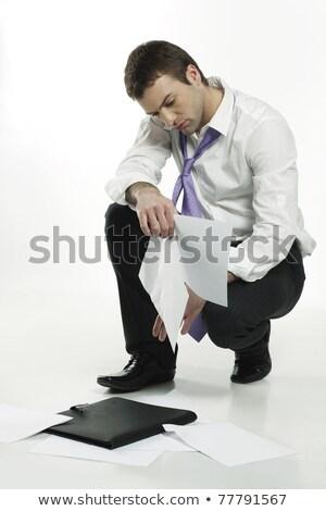 businessmen picking up briefcases stock photo © dacasdo