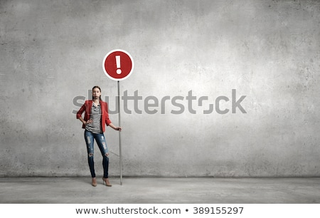 Woman holding traffic sign Stock photo © photography33