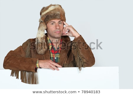 A trapper holding up a blank sign Stock photo © photography33