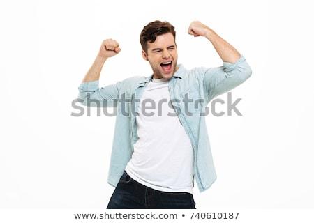 Boldog fiatalember karok felfelé izolált fehér Stock fotó © iko