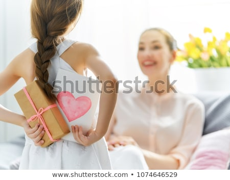 Stock photo: gift giving   child giving a present