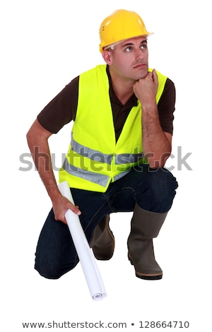 Pensive laborer crouching on white background Stock photo © photography33