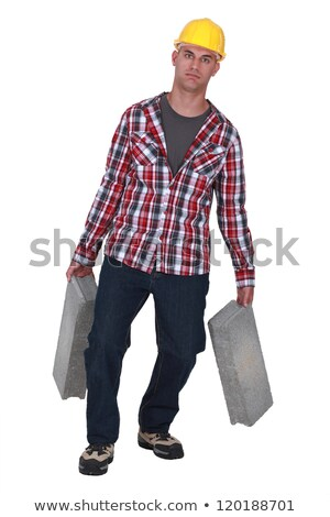 Construction worker carrying a pickaxe Stock photo © photography33
