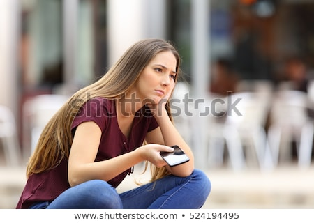 Woman waiting for her friend to arrive Stock photo © photography33