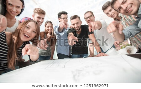 Young male architect pointing at copy space Stock photo © stockyimages