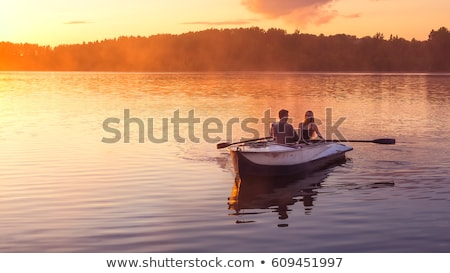 Couple relaxing by the lake Stock photo © photography33