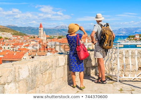 Senior tourist in an old stone building Stock photo © photography33
