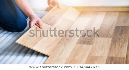 man fitting laminate flooring stock photo © photography33