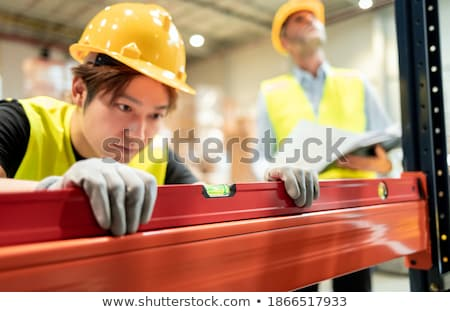 Bricklayer using a steel measure Stock photo © photography33
