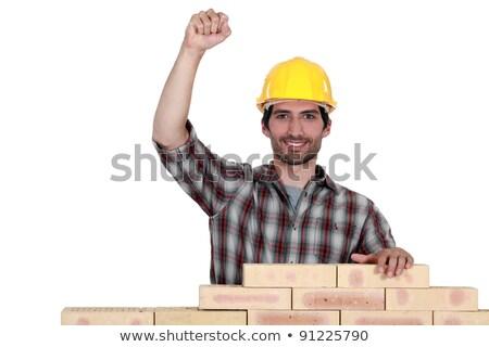 happy mason lifting fist stock photo © photography33
