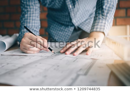 Engineer reviewing paperwork Stock photo © photography33