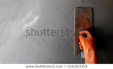 Mason smoothing wall Stock photo © photography33