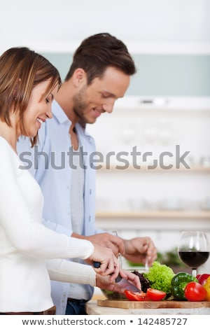 Happy couple stood together in the kitchen Stock photo © photography33