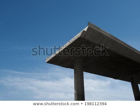 highway built under a cliff stock photo © bbbar