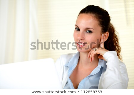Sophisticated young woman looking at you Stock photo © pablocalvog