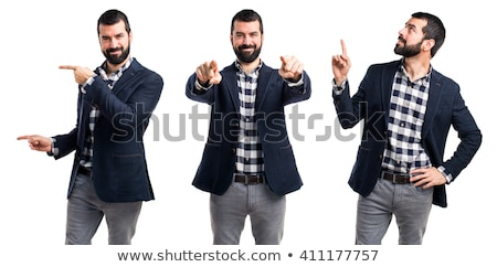 young man pointing finger at you stock photo © stockyimages