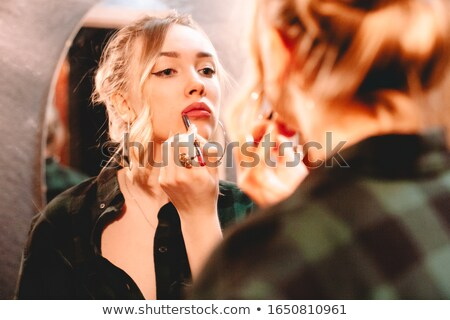 Young woman is doing make up using pink lip liner Stock photo © moses
