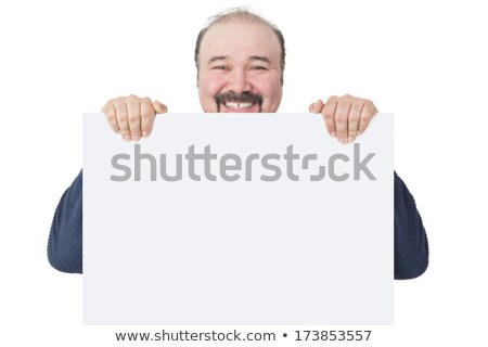 man with a cheesy grin holding a blank sign stock photo © smithore
