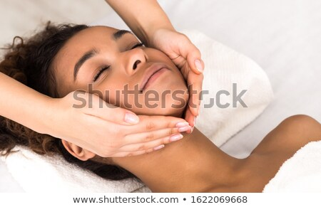 woman in spa gets a facial massage stock photo © stockyimages