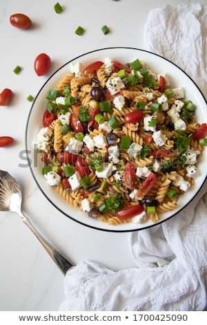 Spring onions and cherry tomato in bowl  Stock photo © natika