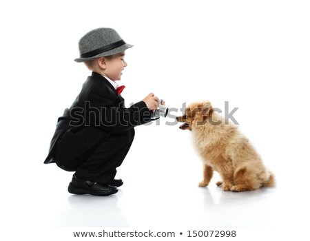 Stock photo: Little boy in hat and black suit with vintage camera isolated on white background