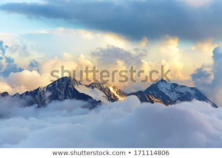Snow mountains and sky with clouds Stock photo © BSANI