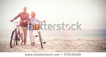 couple walking on the beach stock photo © dolgachov