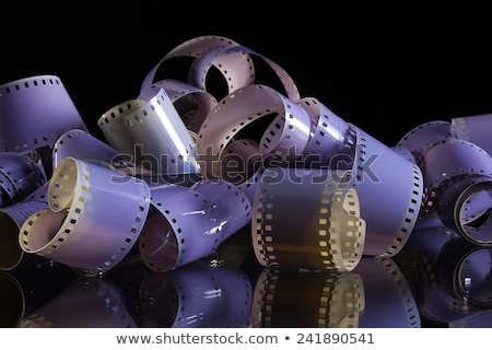 Close-up of a roll 35 mm photographic films on a glass desk Stock photo © CaptureLight