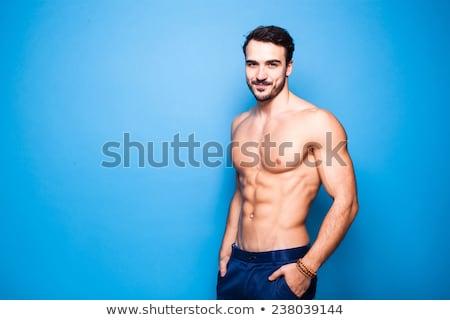 Fit shirtless man smiling at camera Stock photo © wavebreak_media