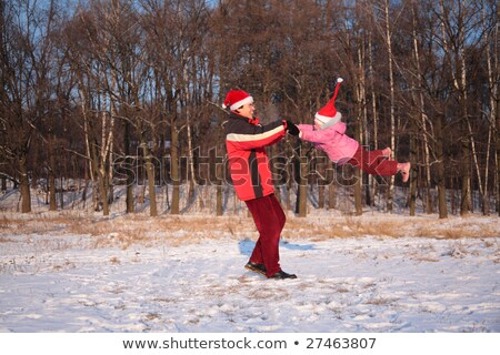 father rotate daughter in wood in winter Stock photo © Paha_L