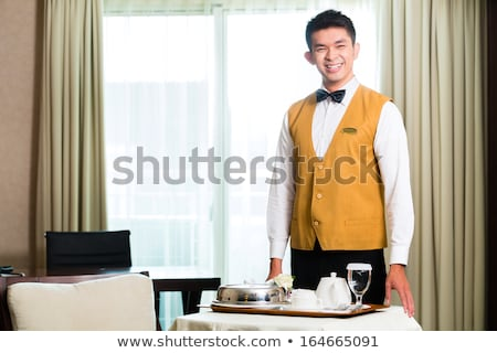 asian chinese room waiter serving food in hotel suite stock photo © kzenon