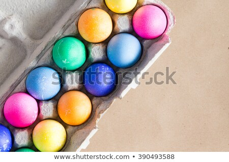 Vibrant hand dyed colorful Easter eggs in a box Stock photo © ozgur