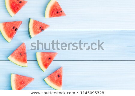 watermelon slice on rustic wooden table top view stock photo © stevanovicigor