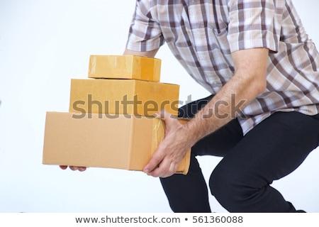 Jóvenes mensajero cajas vista lateral aislado gris Foto stock © deandrobot