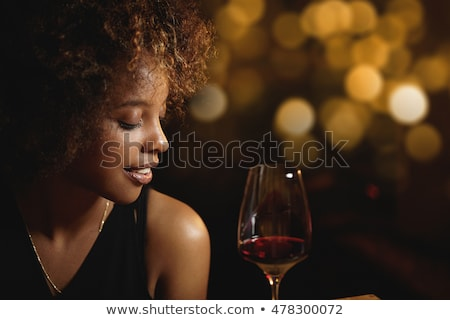 Attractive african american young woman with red lips Stock photo © deandrobot
