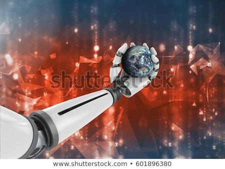 Stock fotó: Robot Hand Against Globe In Background
