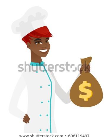 African-american chef cook holding a money bag. Stock photo © RAStudio