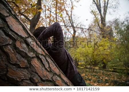 Thoughtful man leaning on tree trunk Stock photo © wavebreak_media