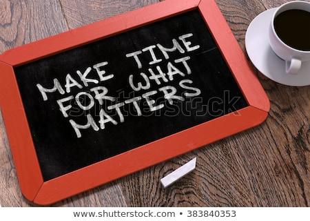 hand drawn make time for what matters concept on chalkboard stock photo © tashatuvango