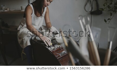 Excited female potter molding a clay Stock photo © wavebreak_media