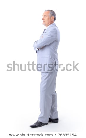 smiling man with hand in pocket holding coat on shoulder stock photo © feedough