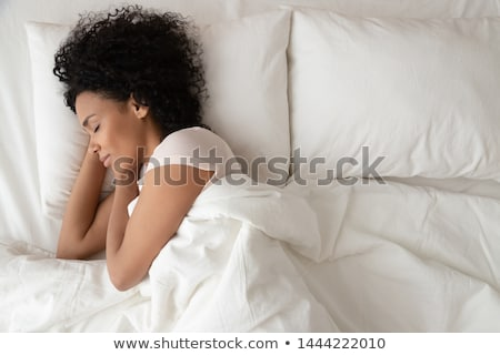 woman sleeping peacefully on bed stock photo © wavebreak_media