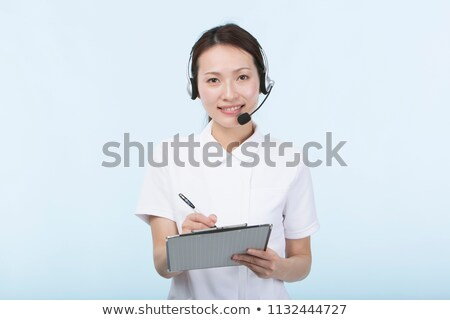 young doctor with phone headset isolated on white stock photo © elnur