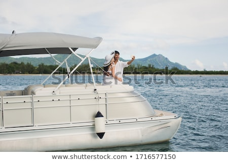 Woman sailing, taking the wheel Stock photo © IS2