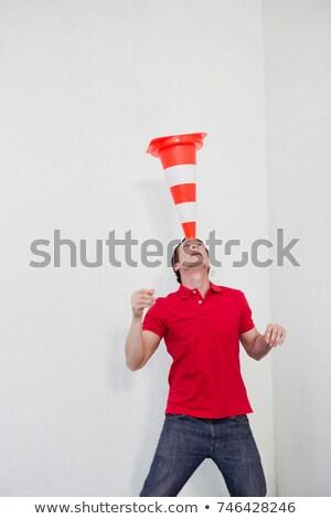man balancing a pylon on his head Stock photo © IS2