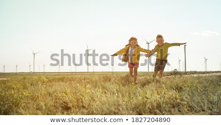 girl and boy at Wind Turbines Stock photo © IS2