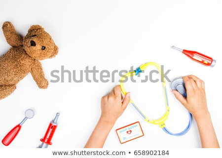 Doctor listening to teddy bear's heart Stock photo © IS2